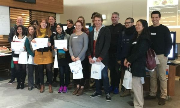 University of Melbourne 2016 competition entrants standing with certificates and competition judge, Simon Clews